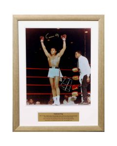 photo is of a young Ali, arms aloft celebrating after a win.